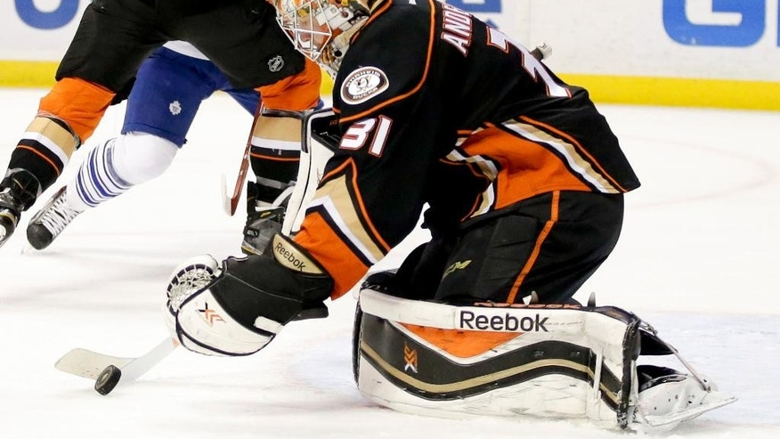 Anaheim Ducks goalie Frederik Andersen blocks a shot against the Toronto Maple Leafs during the first period of an NHL hockey game in Anaheim, Calif., Wednesday, Jan. 14, 2015. (AP Photo/Chris Carlson)
