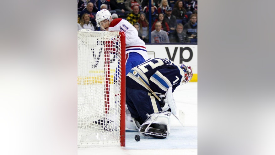 Montreal Canadiens' Brendan Gallagher, left, watches his shot against Columbus Blue Jackets goalie Sergei Bobrovosky, of Russia, during the first period of an NHL hockey game in Columbus, Ohio, Wednesday, Jan. 14, 2015. The call of a goal was reversed. (AP Photo/Paul Vernon)