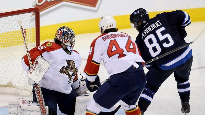 Winnipeg Jets' Mathieu Perreault (85) is stopped by Florida Panthers goaltender Al Montoya (35) with Erik Gudbranson (44) in front of the net during the third period of an NHL hockey game Tuesday, Jan. 13, 2015, in Winnipeg, Manitoba. (AP Photo/The Canadian Press, Trevor Hagan)
