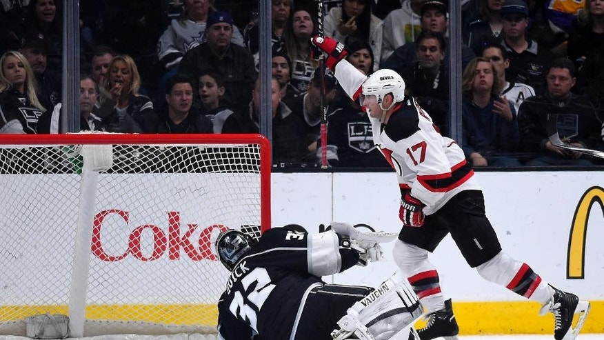 New Jersey Devils right wing Michael Ryder, right, celebrates after scoring on Los Angeles Kings goalie Jonathan Quick during the second period of an NHL hockey game, Wednesday, Jan. 14, 2015, in Los Angeles. (AP Photo/Mark J. Terrill)