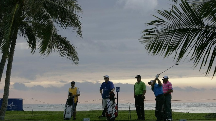 RETRANSMISSION TO CORRECT YEAR - Mark Wilson drives off the 14th tee during the first round of the Sony Open golf tournament, Thursday, Jan, 15, 2015, in Honolulu, Hawaii.  (AP Photo/Hugh Gentry)