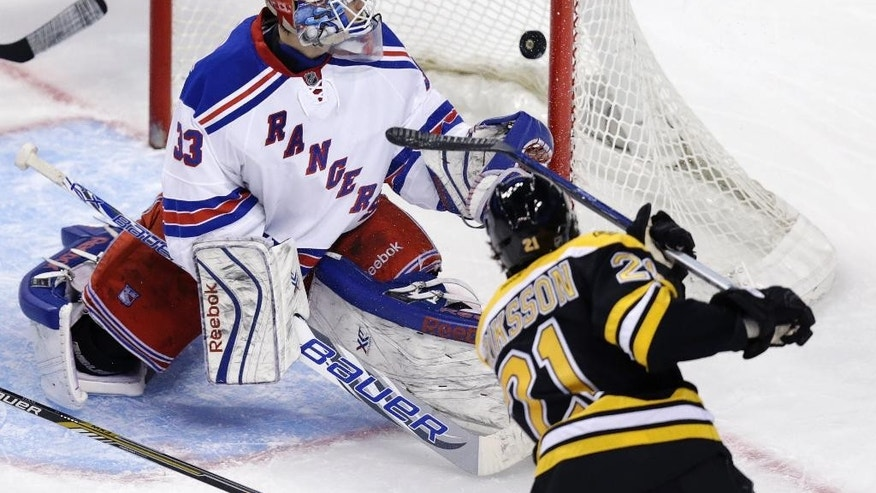 New York Rangers goalie Cam Talbot (33) watches as a shot by Boston Bruins left wing Loui Eriksson passes the post for a goal during the third period of an NHL hockey game in Boston, Thursday, Jan. 15, 2015. (AP Photo/Charles Krupa)