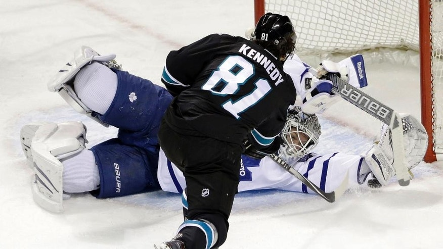 San Jose Sharks' Tyler Kennedy (81) scores past Toronto Maple Leafs goalie James Reimer during the first period of an NHL hockey game Thursday, Jan. 15, 2015, in San Jose, Calif. (AP Photo/Marcio Jose Sanchez)