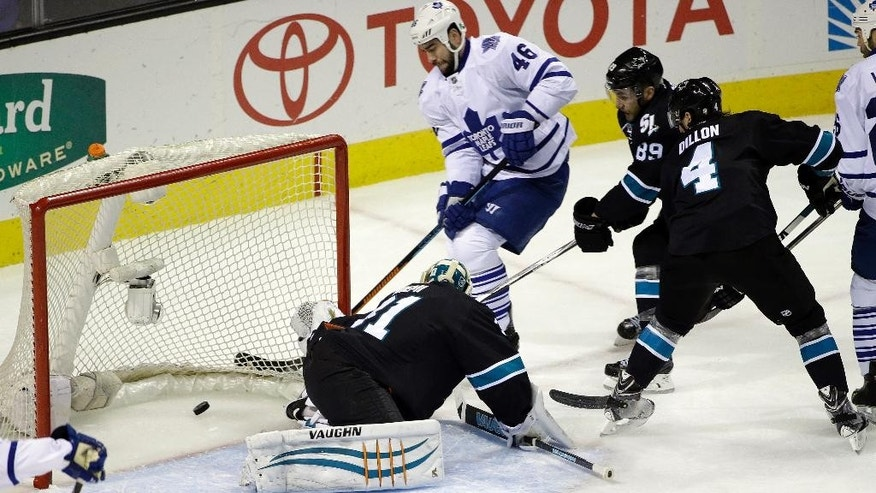 Toronto Maple Leafs' Roman Polak (46) scores past San Jose Sharks goalie Antti Niemi, bottom center, during the first period of an NHL hockey game Thursday, Jan. 15, 2015, in San Jose, Calif. (AP Photo/Marcio Jose Sanchez)