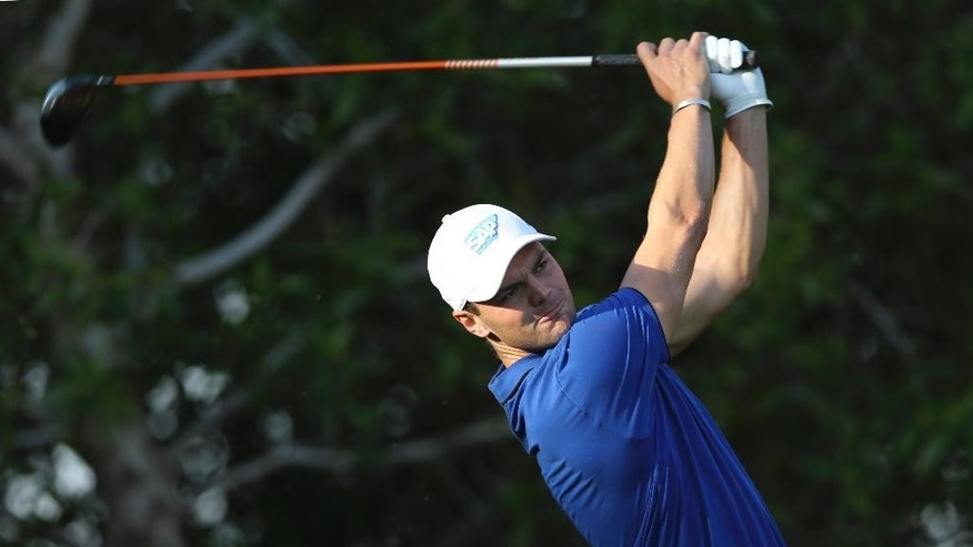 Martin Kaymer of Germany tees off on the 13th hole during the second round of the Abu Dhabi Championship golf tournament in Abu Dhabi, United Arab Emirates, Friday, Jan. 16, 2015. (AP Photo/Kamran Jebreili)