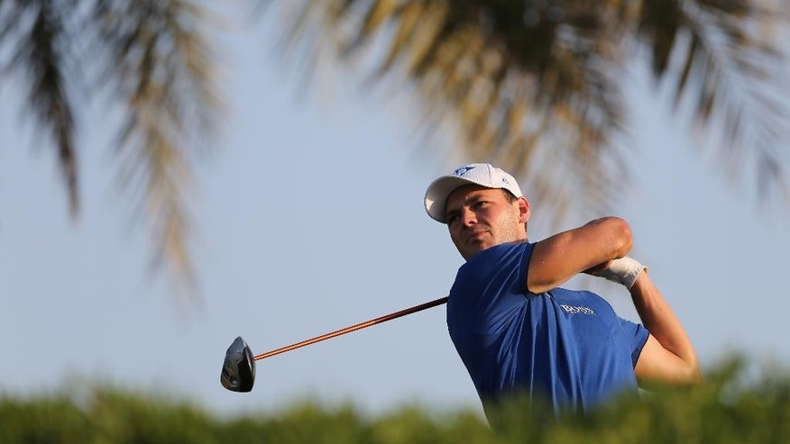 Martin Kaymer of Germany tees off on the 11th hole during the second round of the Abu Dhabi Championship golf tournament in Abu Dhabi, United Arab Emirates, Friday, Jan. 16, 2015. (AP Photo/Kamran Jebreili)