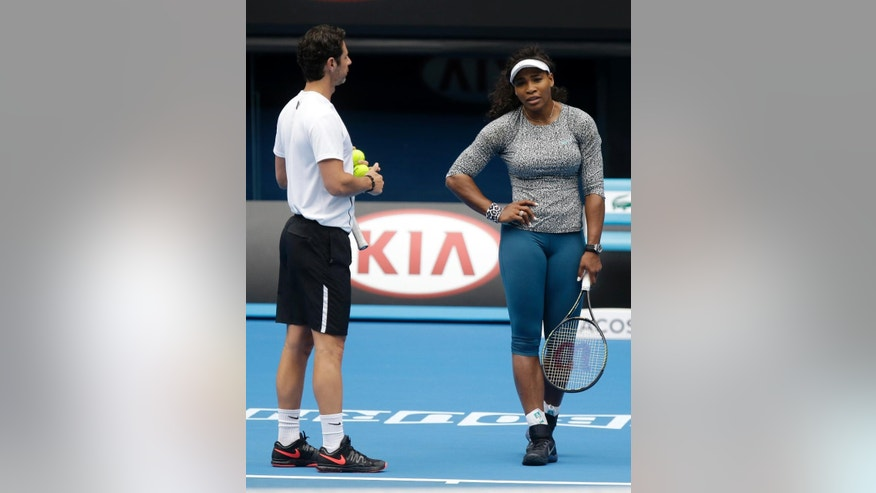 Serena Williams of the US talks with her coach Patrick Mouratoglou during a practice session on Rod Laver Arena ahead of the Australian Open tennis championship in Melbourne, Australia, Thursday, Jan. 15, 2015. (AP Photo/Mark Baker)