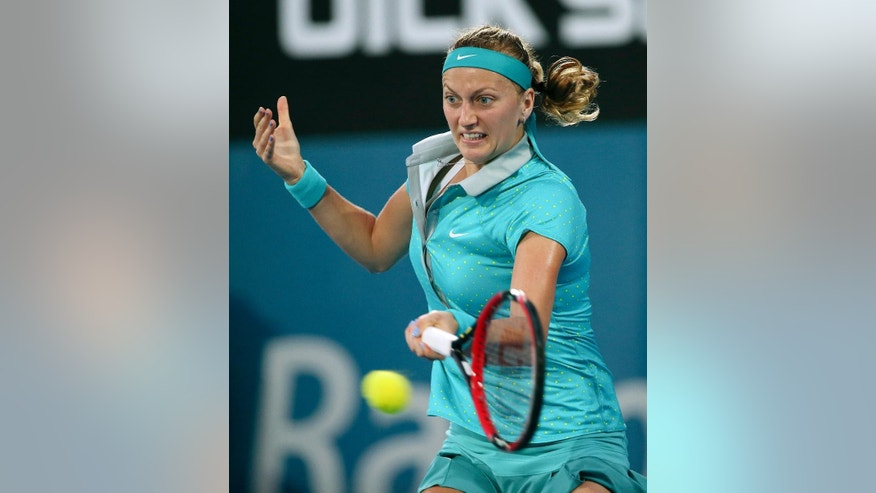 Petra Kvitova of the Czech Republic plays a shot in the women's final match against compatriot  Karolina Pliskova at the Sydney International Tennis tournament in Sydney, Friday, Jan. 16, 2015. (AP Photo/Rob Griffith)