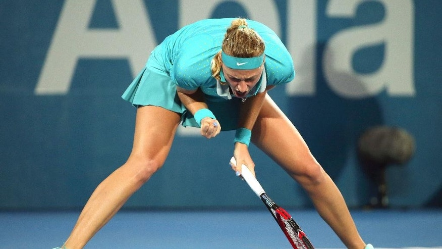 Petra Kvitova of the Czech Republic yells out after winning a break point in the women's final match against compatriot  Karolina Pliskova at the Sydney International Tennis tournament in Sydney, Friday, Jan. 16, 2015. (AP Photo/Rob Griffith)