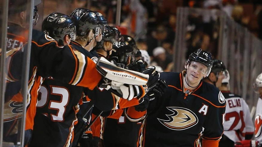 Anaheim Ducks right wing Corey Perry, right, is congratulated by teammates after scoring a goal during the first period of an NHL hockey game against the New Jersey Devils on Friday, Jan. 16, 2015, in Anaheim, Calif.  (AP Photo/Christine Cotter)