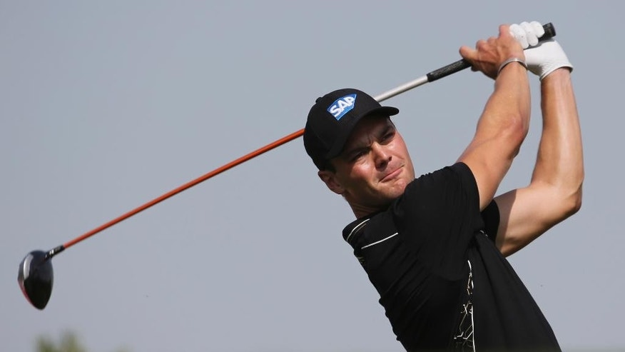 Martin Kaymer of Germany tees off on the 3rd hole during the third round of the HSBC Golf Championship in Abu Dhabi, United Arab Emirates, Saturday, Jan. 17, 2015. (AP Photo/Kamran Jebreili)