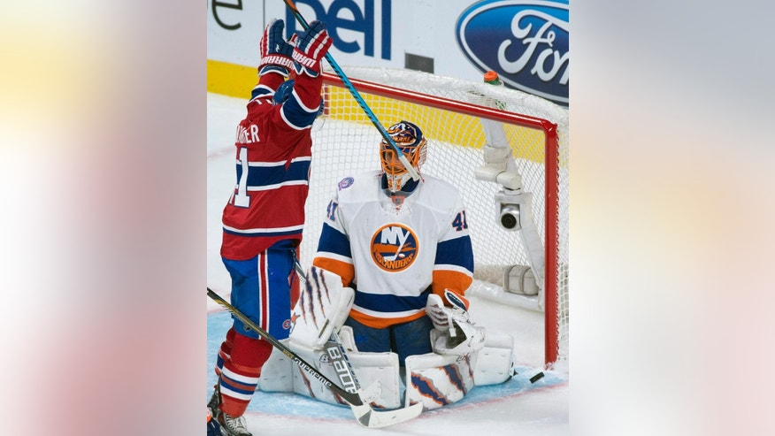 Montreal Canadiens' Brendan Gallagher after teammate Tomas Plekance (not shown) scored on New York Islanders goaltender Jaroslav Halak during second-period NHL hockey game action in Montreal, Saturday, Jan. 17, 2015. (AP Photo/The Canadian Press, Graham Hughes)