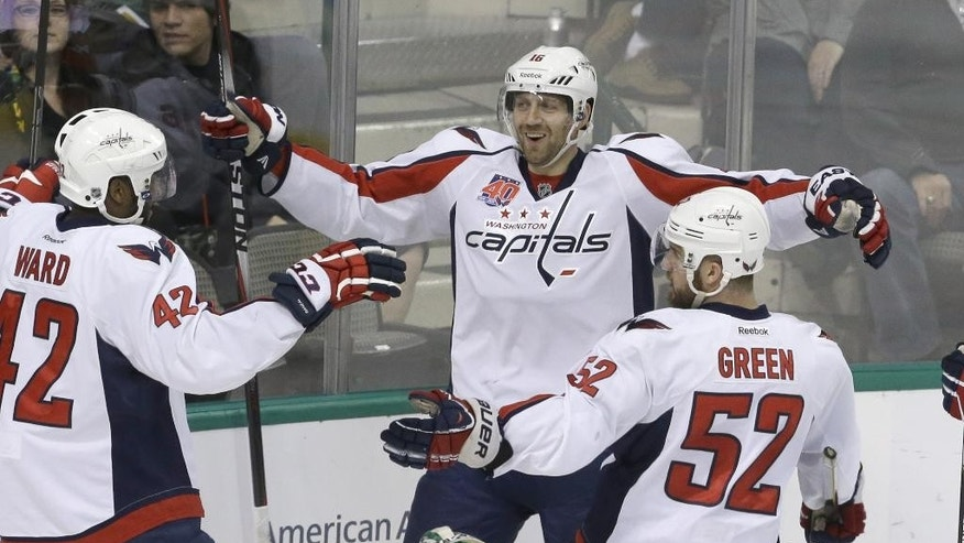 Washington Capitals right wing Eric Fehr (16) celebrates scoring a goal with teammates Joel Ward (42) and Mike Green (52) during the second period of an NHL hockey game against the Dallas Stars on Saturday, Jan. 17, 2015, in Dallas. (AP Photo/LM Otero)