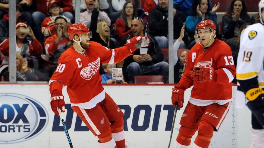 Detroit Red Wings left wing Henrik Zetterberg (40), left, celebrates after scoring a goal with center Pavel Datsyuk (13) against the Nashville Predators during the second period of an NHL hockey game in Detroit, Saturday, Jan. 17, 2015.  (AP Photo/Jose Juarez)