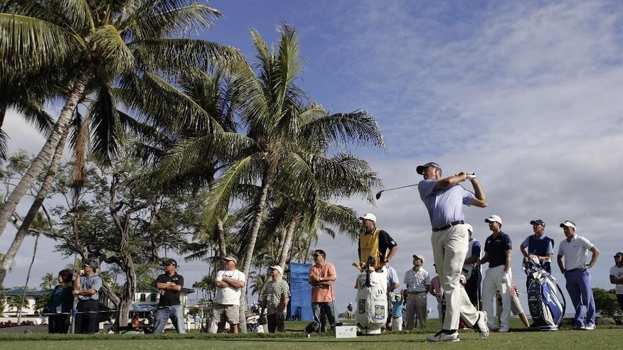 Matt Kuchar drives off the 14th tee during the second round of the Sony Open golf tournament, Friday, Jan, 16, 2015, in Honolulu. (AP Photo/Hugh Gentry)