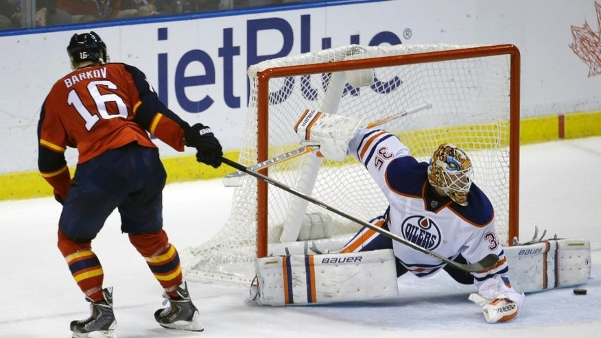 Edmonton Oilers goalie Viktor Fasth, right, blocks a shot by Florida Panthers center Aleksander Barkov (16) during a shootout in an NHL hockey game, Saturday, Jan. 17, 2015, in Sunrise, Fla. The Oilers defeated the Panthers 3-2 in a shootout. (AP Photo/Lynne Sladky)