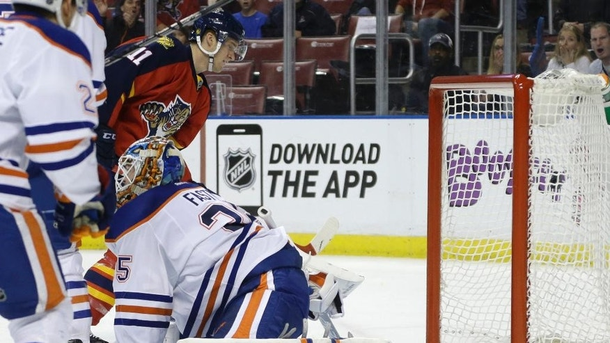 Florida Panthers center Jonathan Huberdeau (11) watches the puck go into the net after scoring a goal against Edmonton Oilers goalie Viktor Fasth (35) in the second period of an NHL hockey game, Saturday, Jan. 17, 2015, in Sunrise, Fla. (AP Photo/Lynne Sladky)