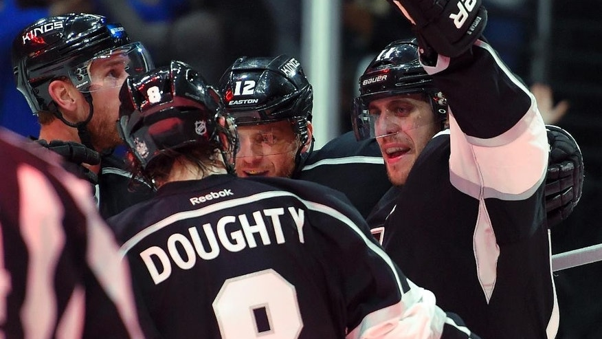 Los Angeles Kings center Anze Kopitar, right, of Slovenia, celebrates his goal against teh Anaheim Ducks with teammates Jeff Carter, left, Drew Doughty, front, and Marian Gaborik, of Slovakia, during the second period of an NHL hockey game, Saturday, Jan. 17, 2015, in Los Angeles. (AP Photo/Mark J. Terrill)