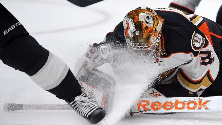 Anaheim Ducks goalie Frederik Andersen, right, of Denmark, gets iced in the face by Los Angeles Kings right wing Marian Gaborik, of Slovakia, during the second period of an NHL hockey game, Saturday, Jan. 17, 2015, in Los Angeles. (AP Photo/Mark J. Terrill)