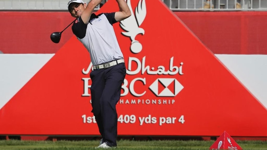 Gary Stal of France tees off on the 1st hole during the third round of the HSBC Golf Championship in Abu Dhabi, United Arab Emirates, Saturday, Jan. 17, 2015. (AP Photo/Kamran Jebreili)