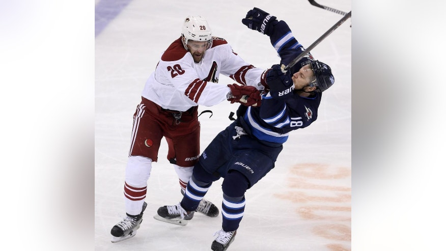 Arizona Coyotes' Chris Summers (20) hits Winnipeg Jets' Bryan Little (18) near center ice during third period NHL hockey action in Winnipeg Sunday,  Jan. 18, 2015.  (AP Photo/The Canadian Press, Trevor Hagan)