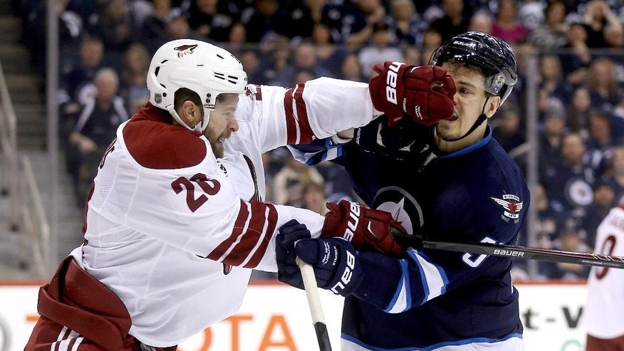 Arizona Coyotes' Chris Summers (20) battles with Winnipeg Jets' Mark Scheifele (55) during second period NHL hockey action in Winnipeg Sunday, Jan. 18, 2015. (AP Photo/The Canadian Press, Trevor Hagan)