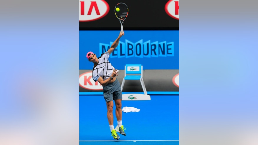 Rafael  Nadal of Spain serves  during a training session at the Australian Open tennis championship in Melbourne, Australia, Sunday, Jan. 18, 2015. (AP Photo/Bernat Armangue)