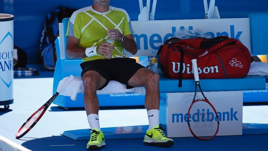 Roger Federer of Switzerland sits in a chair during a training session at the Australian Open tennis championship in Melbourne, Australia, Saturday, Jan. 17, 2015. (AP Photo/Vincent Thian)