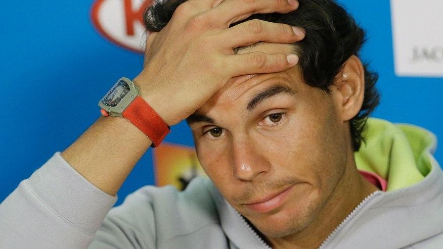 Spain's Rafael Nadal answers a question during a press conference ahead of the Australian Open tennis championship in Melbourne, Australia, Saturday, Jan. 17, 2015. (AP Photo/Lee Jin-man)