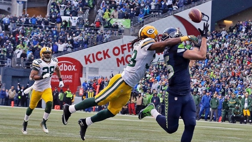 Seattle Seahawks' Jermaine Kearse catches the game winning touchdown pass during overtime of the NFL football NFC Championship game against the Green Bay Packers Sunday, Jan. 18, 2015, in Seattle. The Seahawks won 28-22 to advance to Super Bowl XLIX. (AP Photo/Jeff Chiu)
