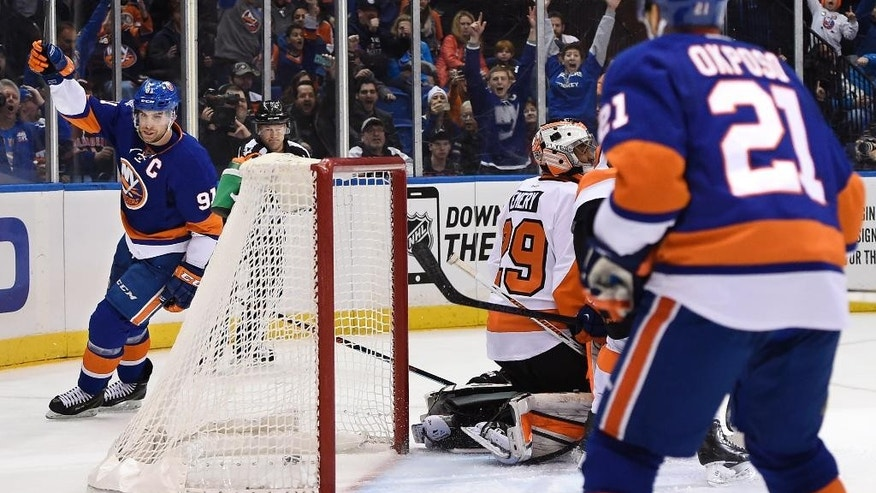 New York Islanders center John Tavares (91) celebrates his goal against Philadelphia Flyers goalie Ray Emery (29)  as Islanders right wing Kyle Okposo (21) looks on in the second period of an NHL hockey game at Nassau Coliseum on Monday, Jan. 19, 2015, in Uniondale, N.Y. (AP Photo/Kathy Kmonicek)