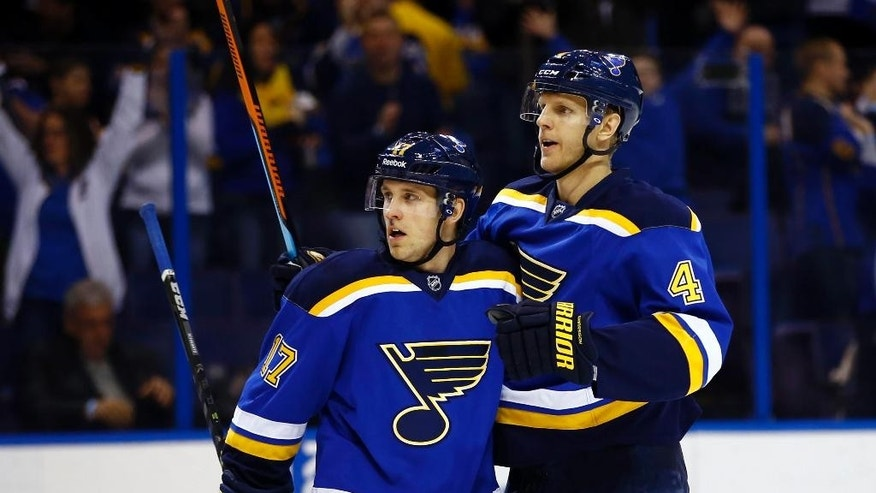St. Louis Blues' Carl Gunnarsson (4), of Sweden, celebrates with teammate Schwartz (17) after scoring a goal during the first period of an NHL hockey game against the Colorado Avalanche, Monday, Jan. 19, 2015, in St. Louis.  (AP Photo/Billy Hurst)