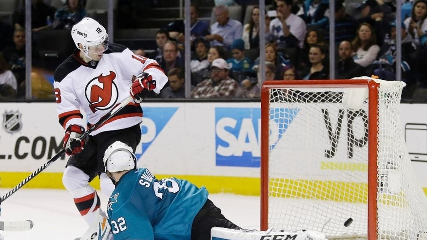 New Jersey Devils' Steve Bernier, top, scores past San Jose Sharks goalie Alex Stalock during the second period of an NHL hockey game Monday, Jan. 19, 2015, in San Jose, Calif. (AP Photo/Marcio Jose Sanchez)