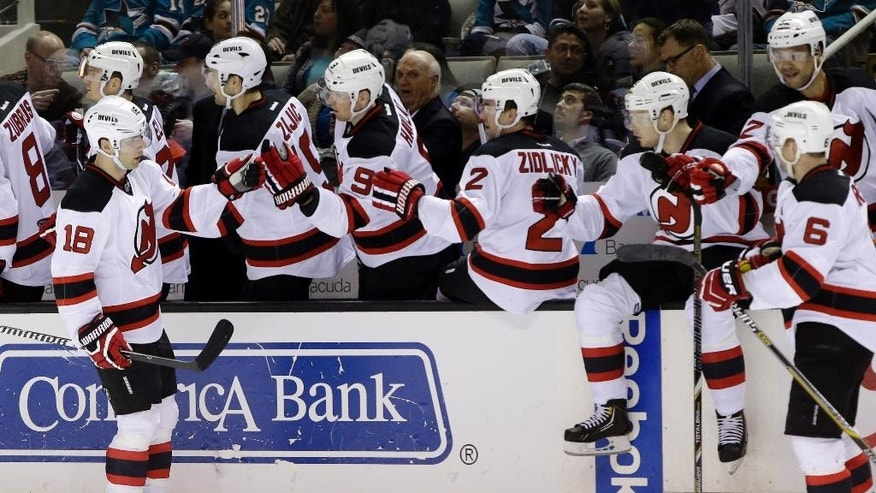 New Jersey Devils' Steve Bernier (18) celebrates his goal with teammates on the bench during the first period of an NHL hockey game against the San Jose Sharks Monday, Jan. 19, 2015, in San Jose, Calif. (AP Photo/Marcio Jose Sanchez)