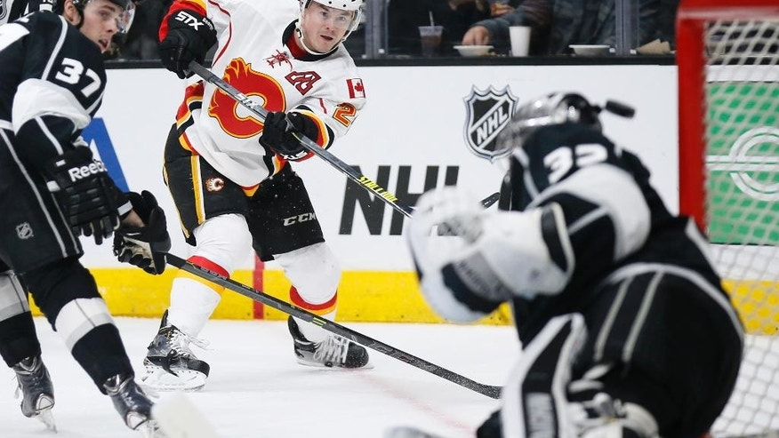 Calgary Flames left wing Jiri Hudler misses a shot past the head of Los Angeles Kings goalie Jonathan Quick while Los Angeles Kings center Nick Shore, left, also defends during the first period of an NHL hockey game, Monday, Jan. 19, 2015, in Los Angeles. (AP Photo/Danny Moloshok)