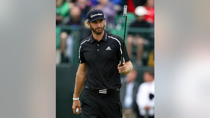 "FILE - In this July 19, 2014, file photo,Dustin Johnson acknowledges the gallery after holing his putt on the first green during the third day of the British Open Golf championship at the Royal Liverpool golf club, Hoylake, England. Johnson says in a magazine interview that cocaine is not the reason he chose to sit out the last six months to get his life in order. Johnson said in August that he was taking a leave of absence from the PGA Tour to seek professional help for what he called ""personal challenges.""   (AP Photo/Jon Super, File)"