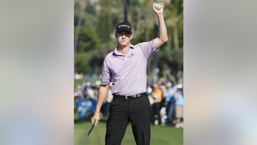 Jimmy Walker celebrates after winning the Sony Open golf tournament, Sunday, Jan. 18, 2015, in Honolulu. (AP Photo/Hugh Gentry)
