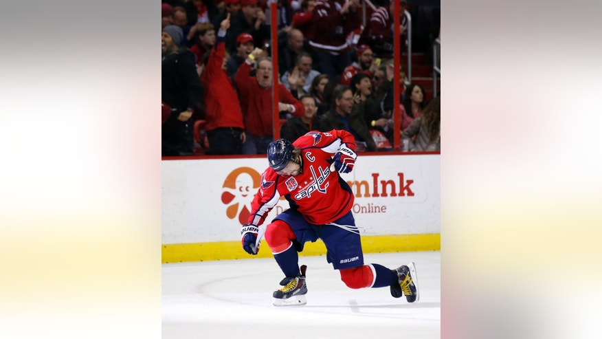Washington Capitals left wing Alex Ovechkin (8), from Russia, celebrates his second goal in the first period of an NHL hockey game against the Edmonton Oilers, Tuesday, Jan. 20, 2015, in Washington. (AP Photo/Alex Brandon)