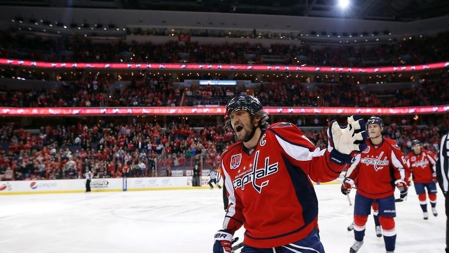 Washington Capitals left wing Alex Ovechkin (8), from Russia, celebrates his first goal in the first period of an NHL hockey game against the Edmonton Oilers, Tuesday, Jan. 20, 2015, in Washington. (AP Photo/Alex Brandon)