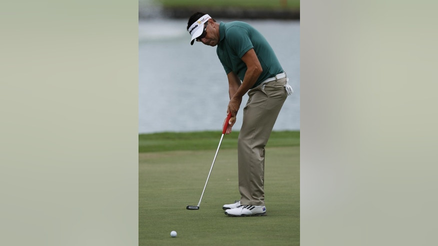 Robert Allenby of Australia putts on the third green during the second round of the Sony Open golf tournament, Friday, Jan. 16. 2015, in Honolulu. Allenby says he was robbed, beaten and dumped in a park Saturday Jan. 17, 2015 after missing the cut in the Sony Open, leaving him with cuts and a deep scrape on his forehead. (AP Photo/Hugh Gentry)