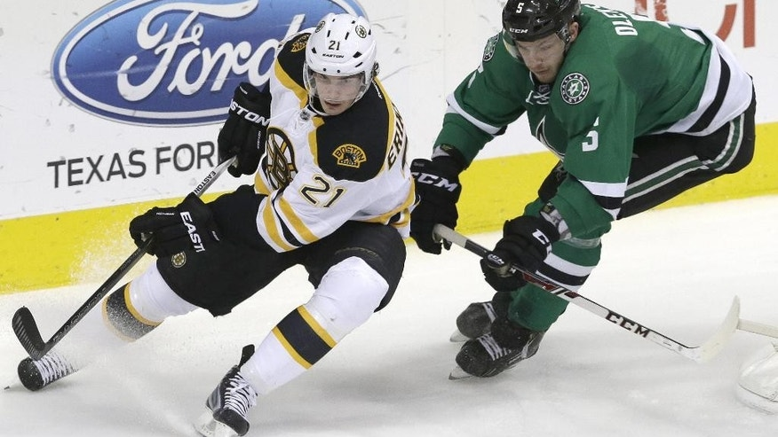Boston Bruins left wing Loui Eriksson (21)  and Dallas Stars defenseman Jamie Oleksiak (5) skate for the puck during the second period of an NHL hockey game Tuesday, Jan. 20, 2015, in Dallas. (AP Photo/LM Otero)