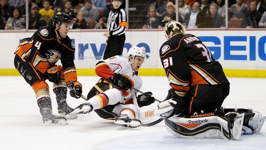 Calgary Flames' Mikael Backlund, center, of Sweden, gets his shot blocked by Anaheim Ducks goalie Frederik Andersen, right, of Denmark, as Ducks' Cam Fowler watches during the first period of an NHL hockey game, Wednesday, Jan. 21, 2015, in Anaheim, Calif. (AP Photo/Jae C. Hong)