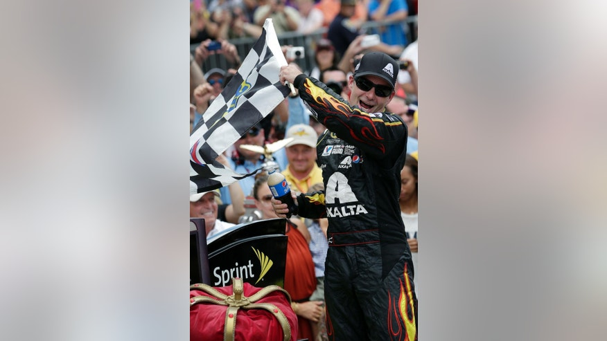 FILE - In this July 27, 2014, file photo, Jeff Gordon celebrates after winning the NASCAR Brickyard 400 auto race at Indianapolis Motor Speedway in Indianapolis. Gordon says he will retire as a full-time  driver after 2015 season. (AP Photo/AJ Mast, File)