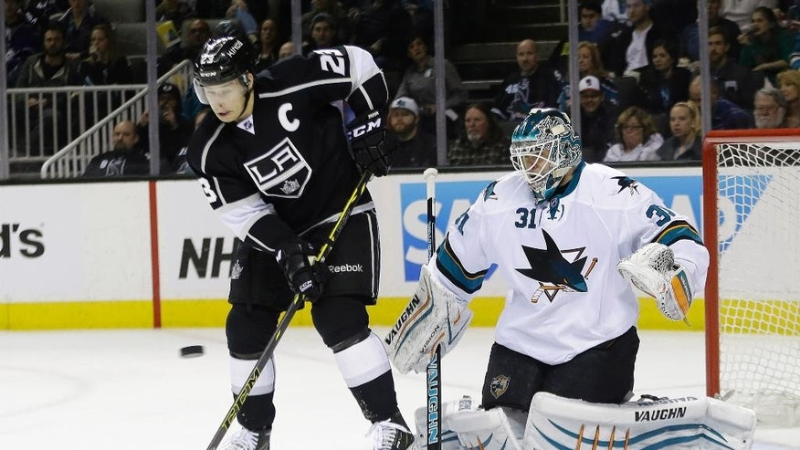 San Jose Sharks goalie Antti Niemi, right, awaits a shot on goal next to Los Angeles Kings' Dustin Brown during the second period of an NHL hockey game Wednesday, Jan. 21, 2015, in San Jose, Calif. (AP Photo/Marcio Jose Sanchez)