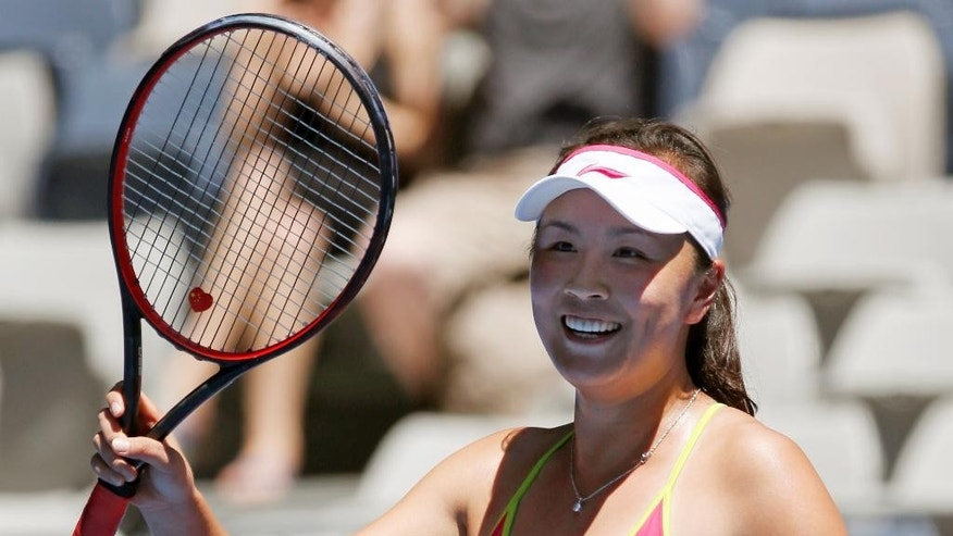 Peng Shuai of China celebrates after defeating Magdalena Rybarikova of Slovakia during their second round match at the Australian Open tennis championship in Melbourne, Australia, Wednesday, Jan. 21, 2015. (AP Photo/Vincent Thian)