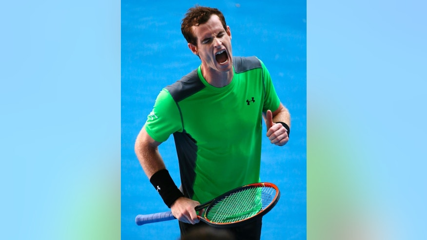 Andy Murray of Britain celebrates a point won against Joao Sousa  of Portugal  during their third round match at the Australian Open tennis championship in Melbourne, Australia, Friday, Jan. 23, 2015. (AP Photo/Vincent Thian)