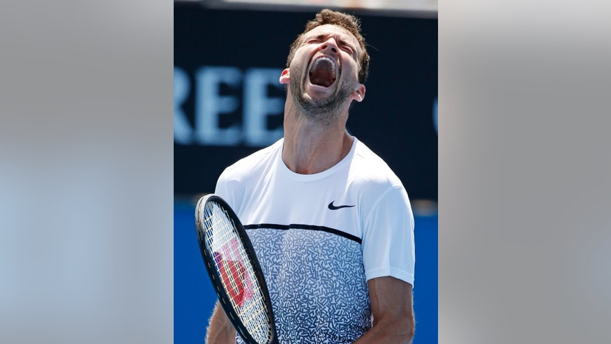 Grigor Dimitrov of Bulgaria yells after defeating Marcos Baghdatis of Cyprus in their third round match at the Australian Open tennis championship in Melbourne, Australia, Friday, Jan. 23, 2015. (AP Photo/Vincent Thian)