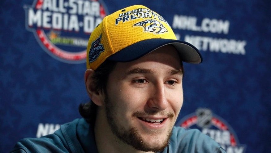 Nashville Predators' Filip Forsberg, of Sweden, is interviewed during media day at the NHL All-Star hockey weekend in Columbus, Ohio, Friday, Jan. 23, 2015. (AP Photo/Gene J. Puskar)