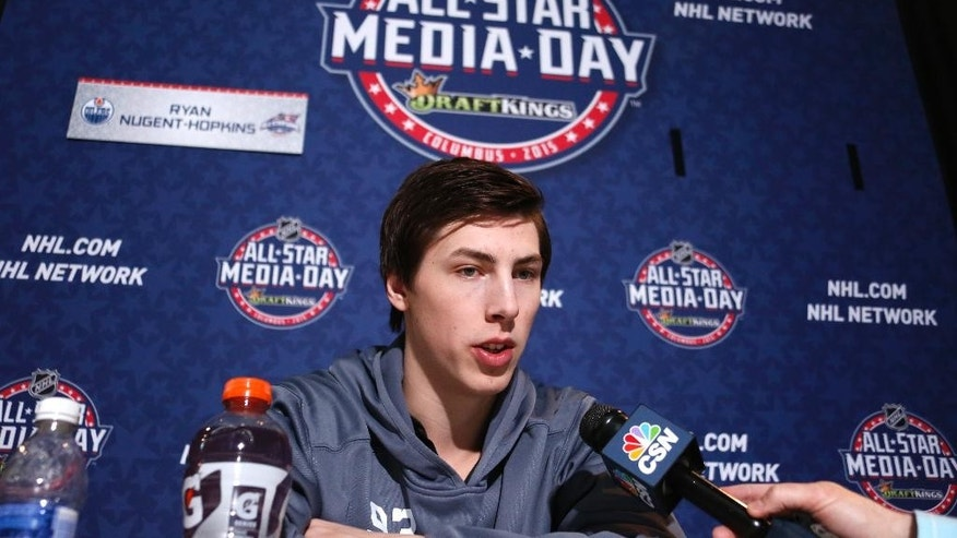 Edmonton Oilers' Ryan Nugent-Hopkins is interviewed during media day at the NHL All-Star hockey weekend in Columbus, Ohio, Friday, Jan. 23, 2015. (AP Photo/Gene J. Puskar
