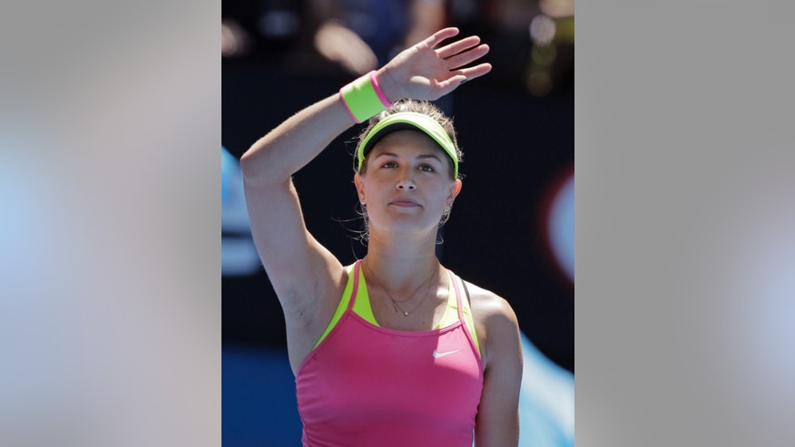 Eugenie Bouchard of Canada waves after defeating Caroline Garcia of France during their third round match at the Australian Open tennis championship in Melbourne, Australia, Friday, Jan. 23, 2015. (AP Photo/Bernat Armangue)
